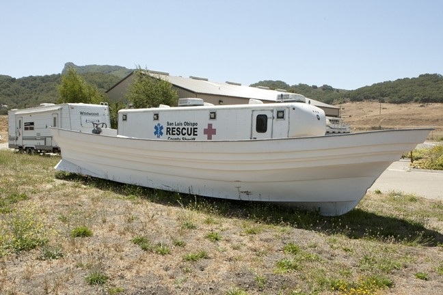 SEAWORTHY AND THEN SOME :  Panga boats, such as the one discovered in a desolate beach a few miles north of Piedras Blancas (pictured), have become the new favorite for smugglers bringing marijuana—and people—farther and farther north up the California coast. - PHOTOS BY STEVE E. MILLER