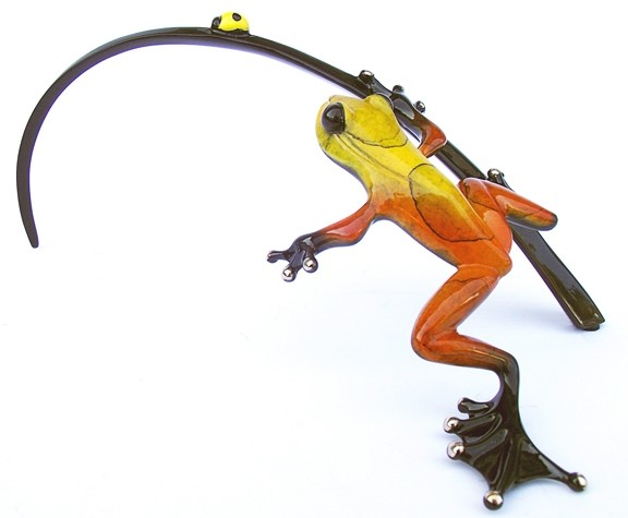 GET HIM WHILE HE'S HOT! :  Hot Shot, pictured, is one of artist Tim Cotterill's original frog designs, exclusively made for Cambria's Artifacts Gallery. Proceeds from this golden beauty benefit Hospice of SLO County. - PHOTO BY CELESTE GOYER