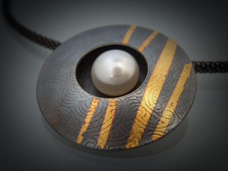 "I'LL FOLLOW THE SUN:  Ina Hohensee's ""wearable art"" jewelry, including her Sun Pendant (pictured), weds contemporary forms with elements from nature. - PHOTO COURTESY OF STUDIOS ON THE PARK"