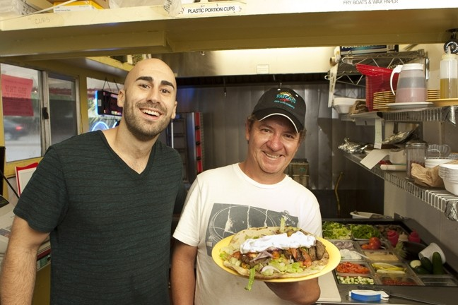 HERO OF THE GYROS :  Samir Aburashed and Chef Antonio Ruiz show off their gyro sandwich. - PHOTO BY STEVE E. MILLER
