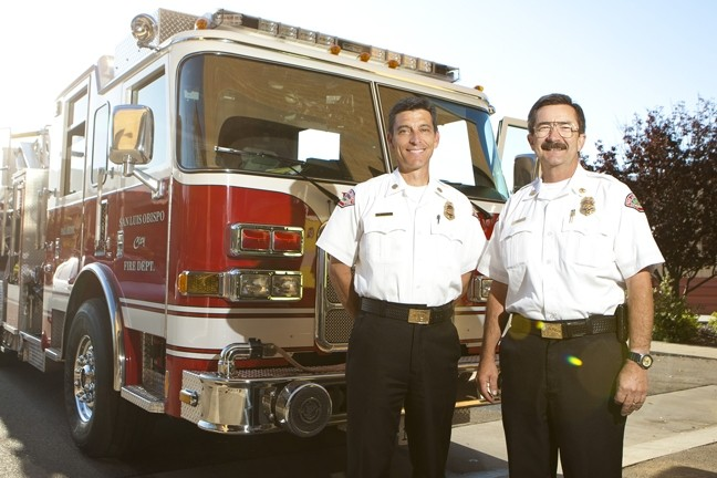 PASSING THE AXE:  San Luis Obispo's current deputy fire chief Garret Olson (left), will take over for the outgoing Charlie Hines on Sept. 12. - PHOTO BY STEVE E. MILLER