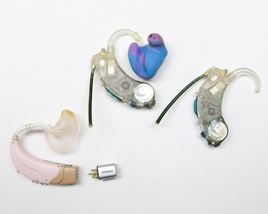 MULTIPLE MODELS:  Hearing aids advance all the time. The latest model is on the left, with older ones on the right. - PHOTO BY STEVE E. MILLER