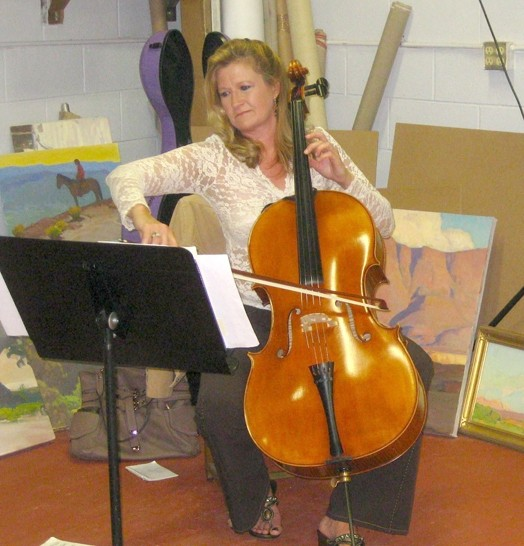 BACKGROUND MUSIC :  Lynne Oliverius, a cellist with the SLO Chamber Orchestra, provided soothing melodies to put folks in the art-viewing mood. - PHOTO BY NICK POWELL