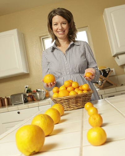 HEALTHY CHOICE :  To help Oceano Elementary School students concentrate on nourishing foods, Kelly Lynch employs such tactics as a ballot for tangerines versus oranges. - PHOTO BY STEVE E. MILLER