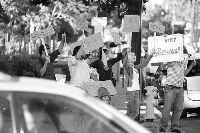 VAGUE PROTEST :  On July 23 New Arts Collective staged a vague protest at the downtown Farmer's Market in SLO. - PHOTO BY STEVE E. MILLER