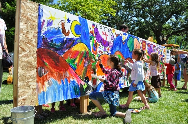 IN SITU:  ARTSFEST attendees add to a communal mural. - PHOTO COURTESY OF STUDIOS ON THE PARK