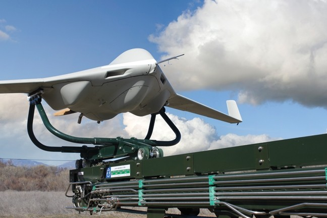 NO PILOT REQUIRED :  A San Luis Obispo facility that designs and builds small unmanned aerial vehicles like this one—used by the U.S. military in Afghanistan and Iraq—has been bought by military giant Lockheed Martin. - PHOTO COURTESY OF LOCKHEED MARTIN