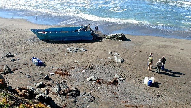 PANGAS ALL THE WAY DOWN:  This panga was recovered from a SLO County beach—one of 12 found since 2012. The boats are used for smuggling operations. - PHOTO COURTESY OF THE SLO COUNTY SHERIFF'S DEPARTMENT