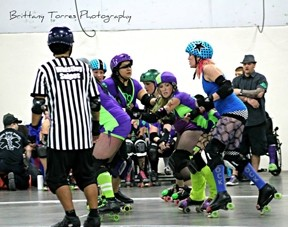 EYE OF THE STORM:  The pack is a dangerous place for any jammer and the Broad St. Brawlers showed the Nor Cal Roller Girls no mercy on Saturday night. - PHOTO BY BRITTANY TORRES PHOTOGRAPHY
