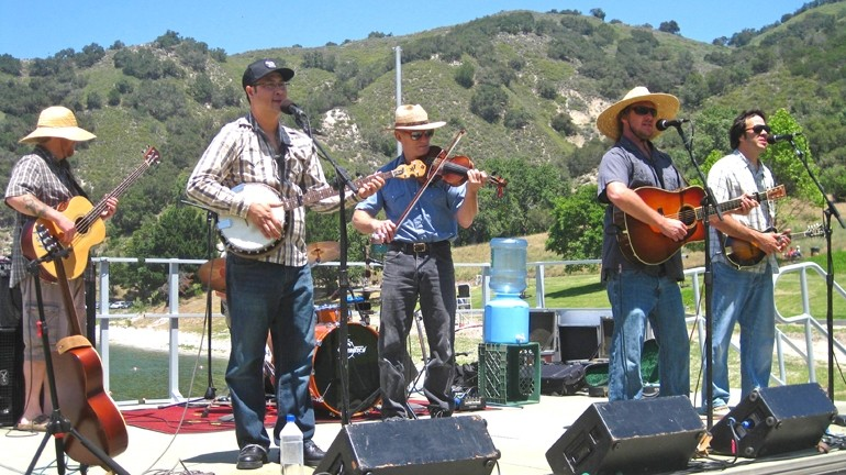 SWINGIN' OUTSIDE :  Cuesta Ridge brought their folksy tunes to a downright beautiful venue by the lakeshore. Zongo Allstars and Morning Rise also took the stage for the Outdoor Discovery Festival. - PHOTO BY NICK POWELL