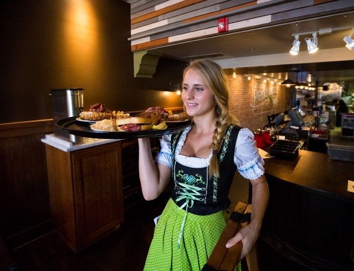 THE GRILLHAUS GETUP:  The food isn't the only thing with a German kick at Wineman GrillHaus on Higuera Street in downtown SLO. Waitresses wear German-style outfits, and owner Jason Luke dons lederhosen. - PHOTO BY KAORI FUNAHASHI