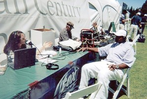 IN THE FIELD:  CJ Silas interviews sports reporter Ahmad Rashad in 2004. While the men she worked with tended to make work miserable, she writes, listeners appreciated her unique take on sports talk. - PHOTO COURTESY OF CJ SILAS