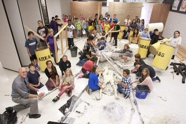 CRAFTY KIDS :  At Los Osos Middle School, Greg Wilcox (bottom left) sat with his students in the Spider Room (not yet completed), which is part of their Area 55 Haunted House creation. - PHOTO BY STEVE E. MILLER