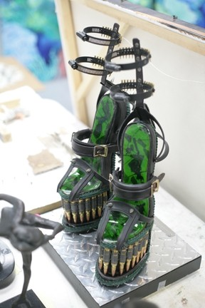 CRUEL SHOES :  Festooned with bullets, hose clamps, and switchblades for heels, these shoes are to die for. - PHOTOS BY GLEN STARKEY