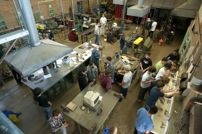 BUSY PIRATE BEES :  The metal shop buzzed with activity as the class came to a close. - PHOTO BY STEVE E. MILLER