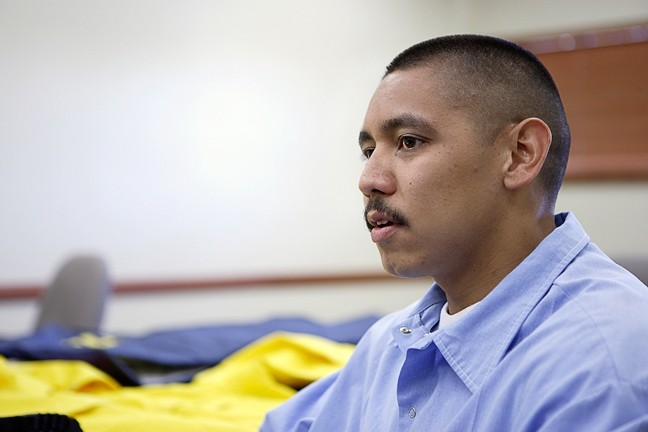 BETWEEN A ROCK AND A HARD PLACE :  Manuel Arias is a model prisoner who's completed his GED and is taking college correspondence courses, but due to mandatory sentencing laws, he'll cost taxpayers another $200,000 before he's released. - PHOTO BY STEVE E. MILLER