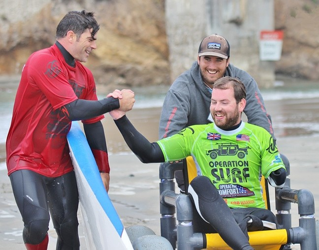 SALT WATER THERAPY :  Operation Surf helps veterans heal their wartime injuries by getting them onto a surfboard and into the ocean. - PHOTO COURTESY OF AMAZING SURF ADVENTURES