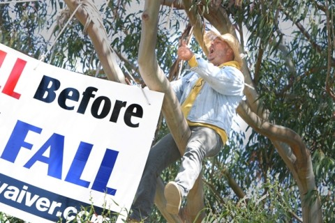 "KID IN A TREE :  Resident Joey Racano, the self-styled ""Los Osos Kid,� threw a shit fit when the project flushed several of his furry friends off the lot at Tri-W. He staged a month-long protest leading up to the September recall."
