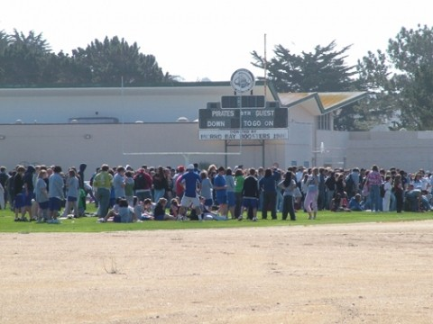FLUSHED OUT :  Hundreds of Morro Bay High School students occupied the campus athletic fields while police investigated a bomb threat Tuesday morning. - PHOTO BY PATRICK M. KLEMZ
