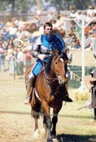 A KNIGHT OUT :  The Knights of the Crimson Rose that's Sir Tyler on the horse will bring full-contact jousting to the faire this year.