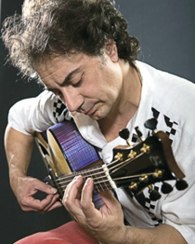FREEDOM GUITARIST :  The world-class French guitarist Pierre Bensusan plays two upcoming SLO Folks shows: March 28 at Coalesce Bookstore and March 29 at Castoro Cellars. - PHOTO COURTESY OF PIERRE BENSUSAN