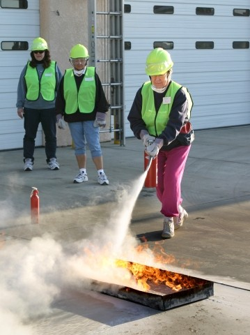 DOUSING THE FLAMES:  CERT trainees learn how to properly put out a fire. - CHRISTOPHER GARDNER