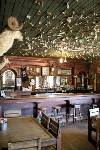 RUSTIC CHARM :  Little has changed about the Pozo Saloon since it was constructed nearly 150 years ago. The interior is decorated with period artifacts, including a little pistol that the owners found while tilling the back field. - PHOTO BY STEVE E. MILLER