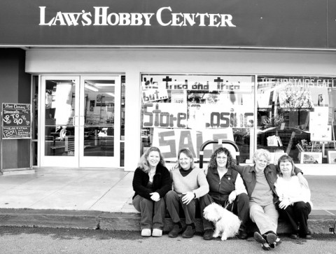 OUT LAW'S :  Longtime employees and owners of Law's Hobby Center, who collectively have worked at the craft store for more than 75 years, sat outside the closing business on Jan. 30. Pictured, from left to right, is Charlene Maddox, owner Bobbie Vasquez, DiAnn Williams, owner Christine Ahern, and owner Sharon Gove. - PHOTO BY STEVE E. MILLER
