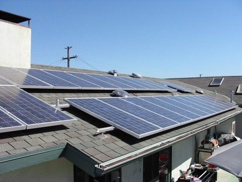 POWER TO THE PEOPLE:  Jeff Oldham of Los Osos powers his home, workshop, Jacuzzi, and more with this 30-panel, 5-kilowatt solar power system, and still has enough energy left over to plug in his neighbors Christmas lights.
