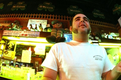 INTO THAT GREEN NIGHT :  McCarthy's bar manager Colin Wenzl serves up the amber wisdom. - PHOTO BY CHRISTOPHER GARDNER