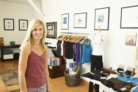 DRESS TO DE-STRESS :  Nicole Wendel recently opened The Yoga Boutique, which offers comfortable clothes and yoga accoutrements. - PHOTO BY STEVE E. MILLER