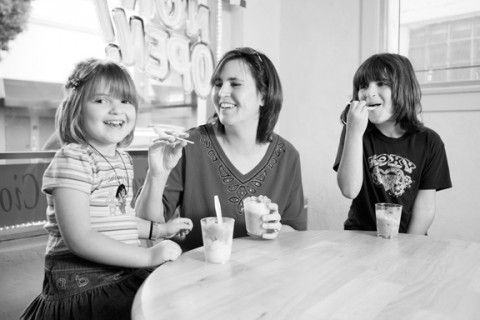 ALL SMILES :  Jo Ann (center), Brianna (right), and Brittany (left) enjoy tasty treats at G's Italian Freeze. - PHOTO BY STEVE E. MILLER