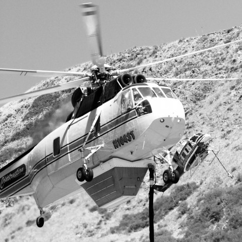 IN FLIGHT :  Helicopters joined a battle to fight a fire that burned a little less than 100 acres in the hills above Cal Poly in October. Dorm dwellers received regular updates and some families were asked to evacuate, but the blaze was contained by the end of the day and no buildings were damaged.