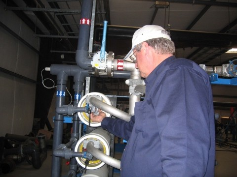 DESALINATION TECHNOLOGY :  Morro Bay's capital projects manager Bill Boucher examines the reverse-osmosis membranes used along with huge amounts of electricity to remove salt from seawater at the Morro Bay desalination plant. - PHOTO BY KATHY JOHNSTON