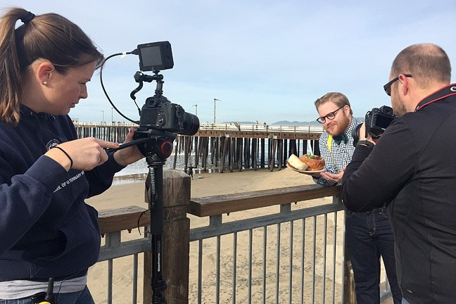 TANTALIZING VIDEOS:  Dream Eater Chase Ramsey enjoys some Splash Café clam chowder by the Pismo Beach Pier during a California Dream Eaters shoot. Juice Media, a Paso-based production company, produces the web series that uses Instagram comments to seek out California's best food and drink. - PHOTO COURTESY OF JUICE MEDIA