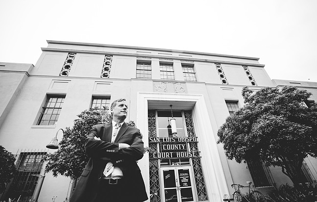 EMBATTLED:  Pismo Beach City Councilmember Erik Howell stands in front of the San Luis Obispo County Courthouse after being appointed to the California Coastal Commission by Gov. Jerry Brown in February 2014. Howell is the subject of a California Fair Political Practices Commission complaint filed by Pismo Beach residents. - FILE PHOTO BY HENRY BRUINGTON