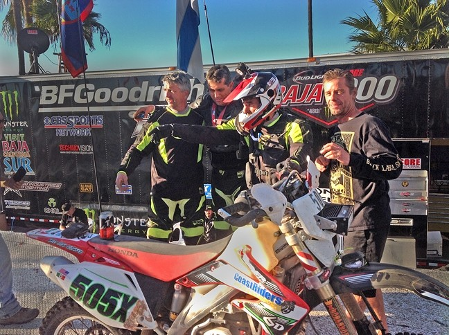 "THE FINISH LINE :  After racing about 840 miles, Timothy ""Scott"" Hayes, Tony Zabala, Dan Argano, and Robert Eaton victoriously unite near the finish line after Argano finishes the last stint of the Baja 1000. - PHOTO COURTESY OF COASTRIDERS POWERSPORTS"
