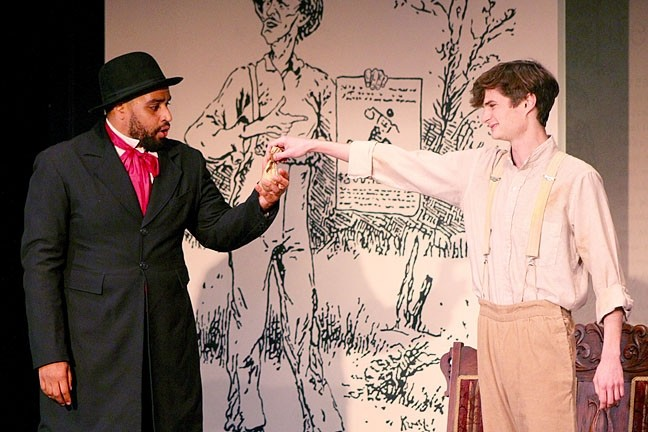 CLASSIC COME TO LIFE:  Huckleberry Finn (Cameron Rose, right) and the runaway slave Jim (Philip Bolton, left) become fast friends through their quest for freedom in 'Across the River,' showing at the Great American Melodrama. - PHOTO COURTESY OF THE GREAT AMERICAN MELODRAMA