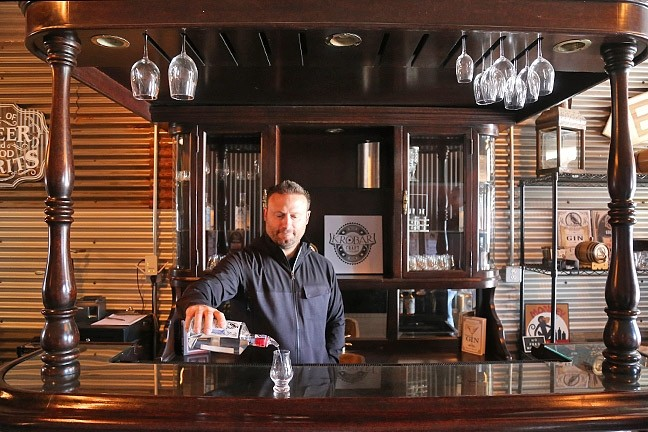 BARKEEP:  KROBĀR Craft Distillery co-owner Stephen Kroener mans the tasting room, nestled behind Grey Wolf Wines. - PHOTO BY DYLAN HONEA-BAUMANN