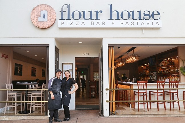 AMERICAN DREAM:  Flour House Owners Alberto and Gessica Russo take a break from making pasta and pizzas at their new restaurant, which celebrated its grand opening late last month. - PHOTO BY DYLAN HONEA-BAUMANN