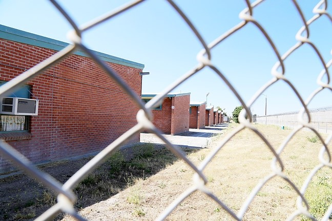 MOON SHOT:  The Estrella Juvenile Correctional Facility in Paso Robles was shut down by the state of California in 2008. Paso Robles Mayor Steve Martin hopes the city can obtain the 160 acres of land by the airport and use part of it for a transitional homeless shelter. - PHOTO BY DYLAN HONEA-BAUMANN