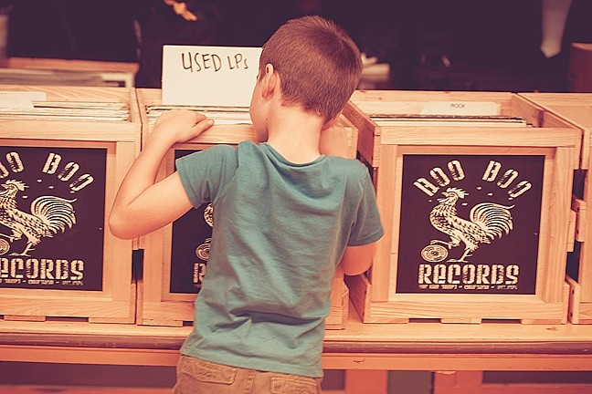 START 'EM YOUNG!:  A kid digs through the stacks at last November's SLO Record Swap, which returns to the SLO Grange Hall on March 12. - PHOTO BY MARIAH SCHWARTZ