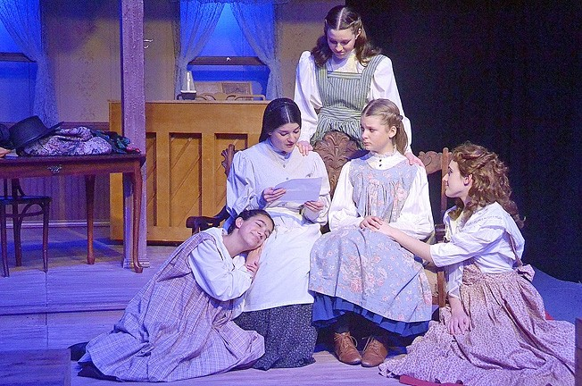 JUST US GIRLS:  Marmee (Allison Warren) reads a letter from Father, who is away at war, to the March sisters, Beth (Abigail Dorman), Jo (Elizabeth Tharp), Amy (Linnae Marks), and Meg (Samantha Mucciacito). - PHOTO COURTESEY JAMIE FOSTER PHOTOGRAPHY