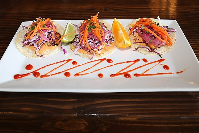 FLAVOR, COLOR, TEXTURE:  Street Side Ale House's snapper tacos with house slaw, macerated onions, pickled veggies, and chipotle Thousand Island dressing are perfect for a fresh meal on a hot Atascadero afternoon. - PHOTO BY DYLAN HONEA-BAUMANN