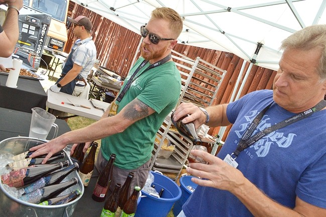CRAFTY:  Firestone Walker Brewing Company held its annual invitational beer festival June 4, in Paso Robles, and brewers such as Wicked Weed Brewing out of Asheville, N.C., brought beers you can't find on the Central Coast. - PHOTO BY DAVID MINSKY
