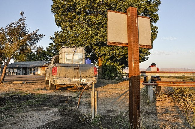 FILL UP:  Marijuana growers and some California Valley residents get their water from this spigot at the Community Services District property. It's now locked up, and if someone wants to fill up a water tank, they need to get approved by the district's general manager and set up an appointment. - PHOTO BY CAMILLIA LANHAM