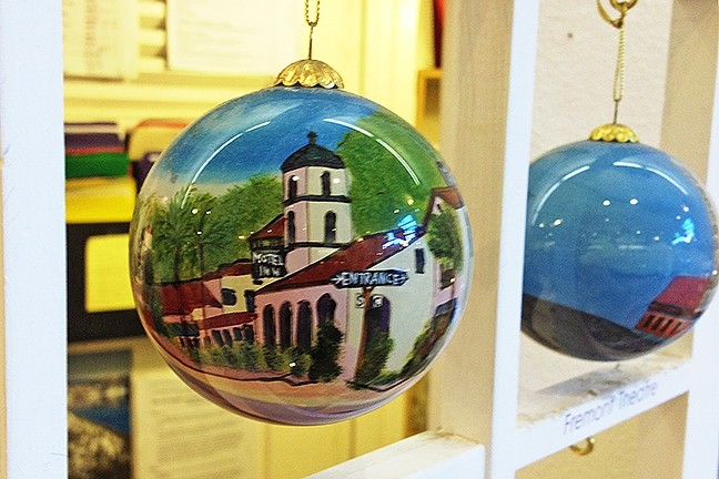 DECK THE HALLS:  SLO-centric gifts, like this Motel Inn ornament, are a hit with my out-of-town family members. - PHOTO BY CHRIS MCGUINNESS