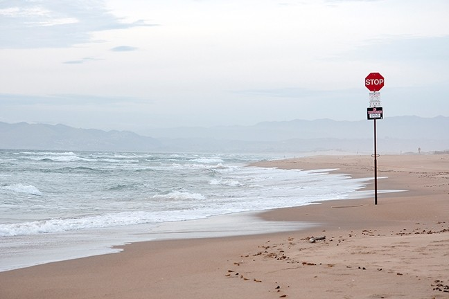 REMNANTS:  A stop sign still stands on the beach, even though off-highway traffic was banned after the Sierra Club sued State Parks over an incident involving a vehicle killing an endangered species in the area. - PHOTO BY CAMILLIA LANHAM