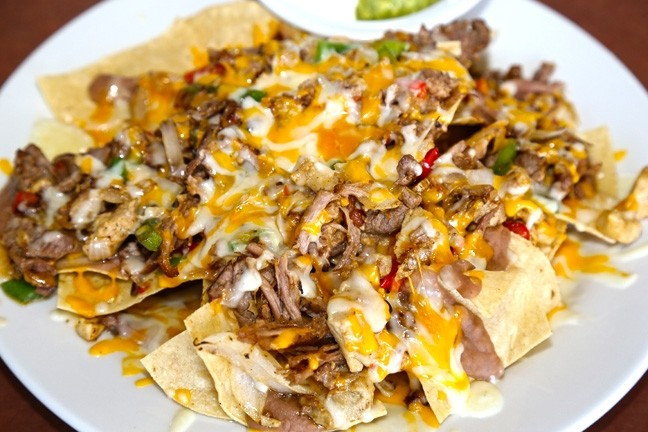 SAVE THEM!:  It's hard to finish a big plate of nachos, but save some for later. A toaster oven will re-crisp up the chips and re-melt that cheese. Just remember to get the guac on the side; nobody likes hot, brown avocado. - FILE PHOTO BY DYLAN HONEA-BAUMANN