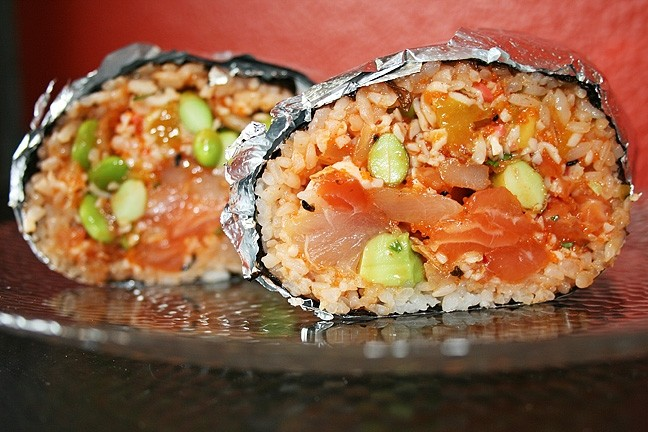 FISH, FOILED:  Poke Chef's sushi burrito is a flavor explosion of salmon, albacore, cucumber, edamame, green and red onion, cilantro, crab salad, kimchi, mango, avocado, crispy onion, and garlic, with a mix of their tangy bomber and lemon ginger sauces. - PHOTO BY HAYLEY THOMAS